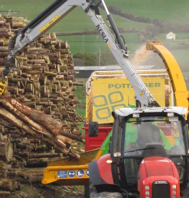 Picture of chipping machine making biomass from coillte timber