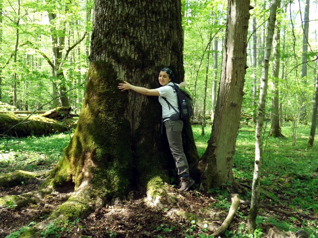 Picture of a graduate forester hugging a tree
