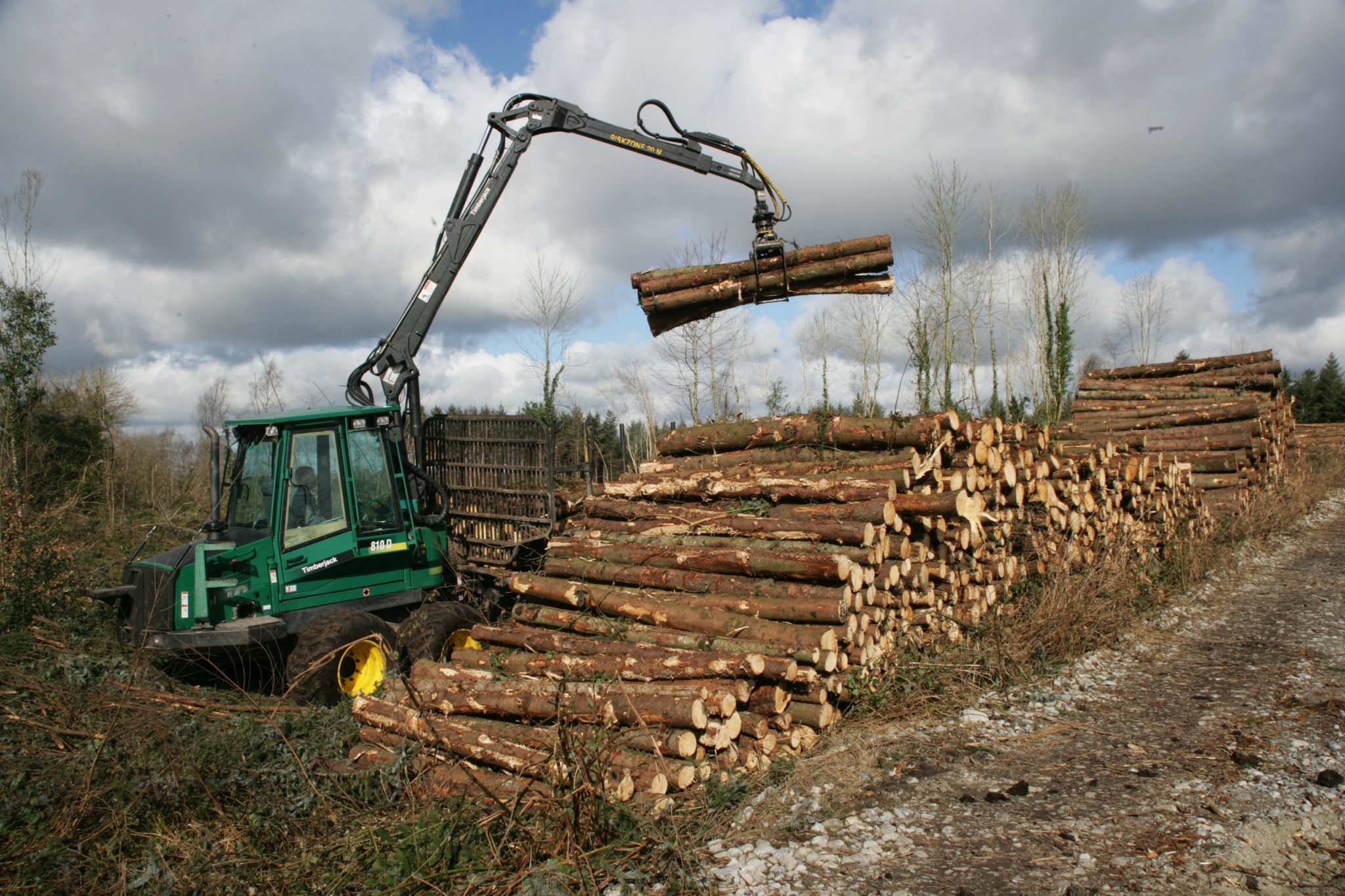 Machine stacking Coillte timber in County Laois