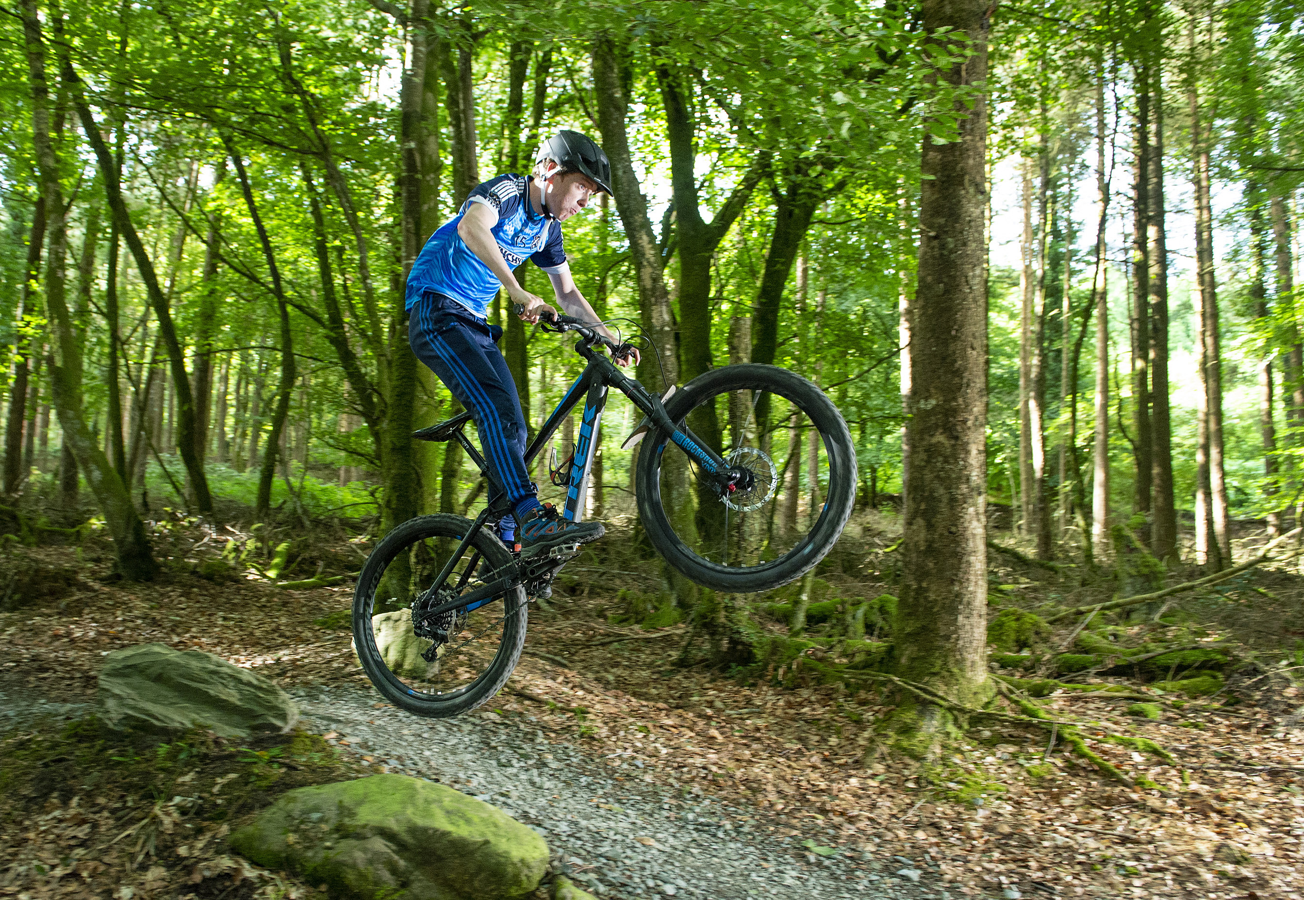 Picture of mountain bike jumping on Coillte's mountain bike trail